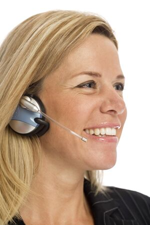 Businesswoman uses a headset and smiles against a white background