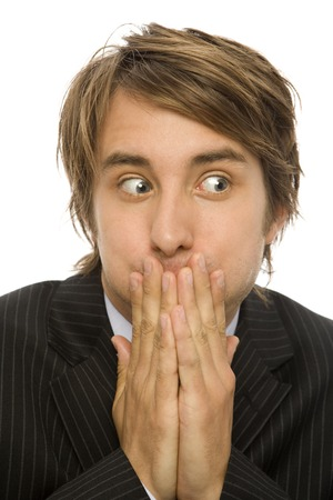 embarassment: Businessman in a suit gestures embarassment and looks away Stock Photo