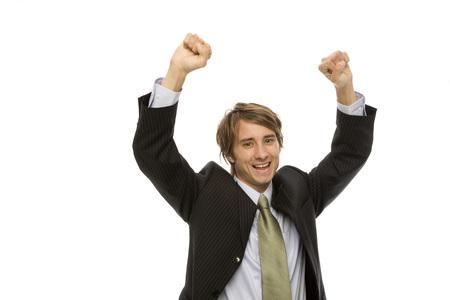 Businessman in a suite raises his arms with triumph Stock Photo