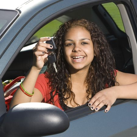 Teen driver shows of her keys and smiles Stock Photo