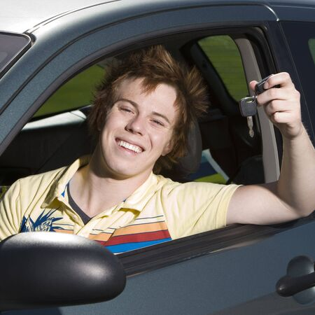 Teen driver shows of his keys and smiles Stock Photo