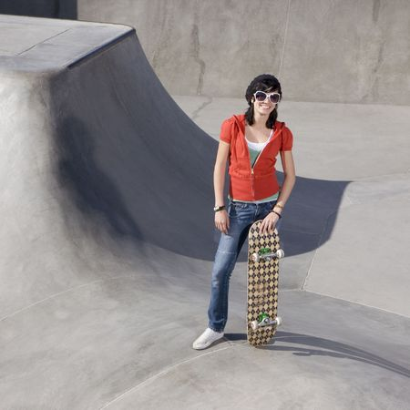 Girl with skateboard at the park