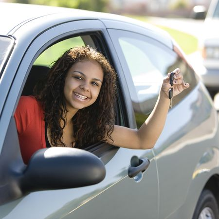 milestones: Teen driver inside car with keys smiles
