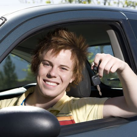Happy teen with keys to car smiles Stock Photo