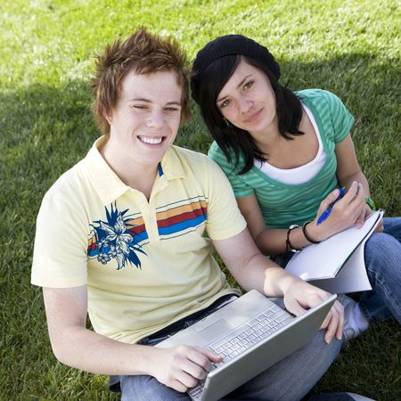 Teen couple do homework Stock Photo - 3569720