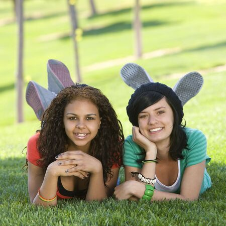 Girlfriends hang out in grass Stock Photo - 3569567