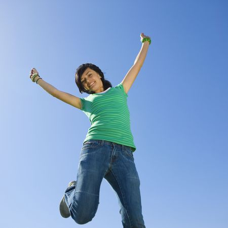 Happy teen jumps in air Stock Photo - 3569513