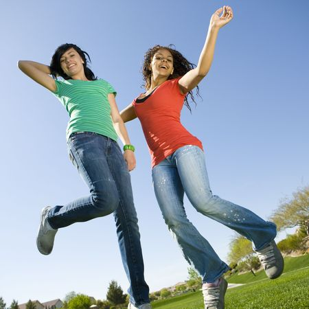 liveliness: Happy teens jump in air