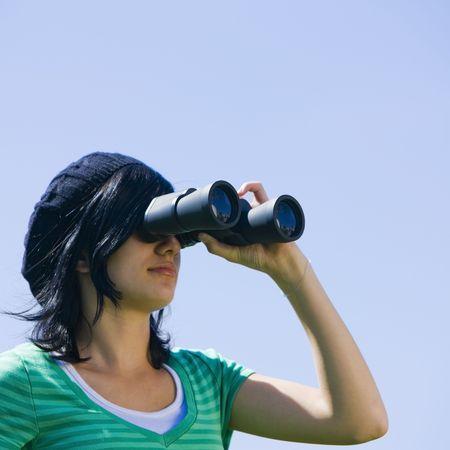 A teenager looks through binoculars Stock Photo - 3569727