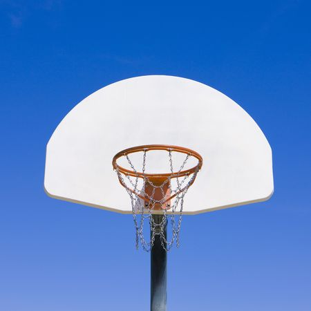 A simple view of a basketball backboard and hoop