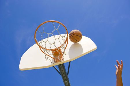 A basketball player throws a basket Stock Photo