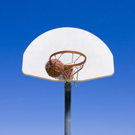 A basketball goes through hoop
