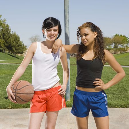 recreational sport: Two teen girls hang out at a basketball court