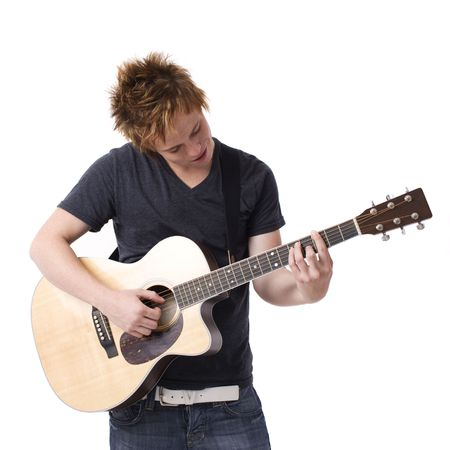A boy plays his guitar Stock Photo