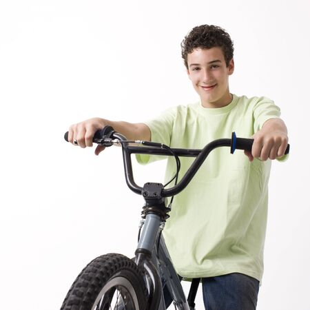 A boy rides a bike and smiles