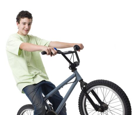 A boy rides his bike and smiles
