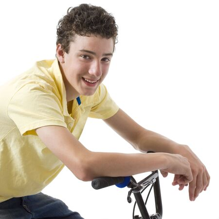 A boy smiles as he leans against his bike Stock Photo