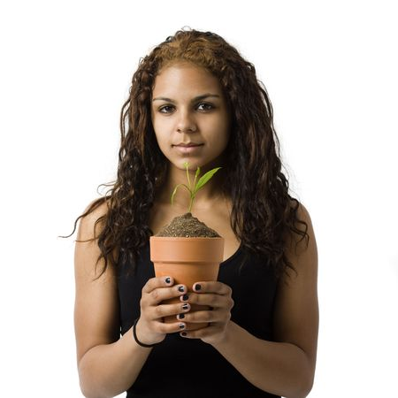 Agirl holds a potted plant