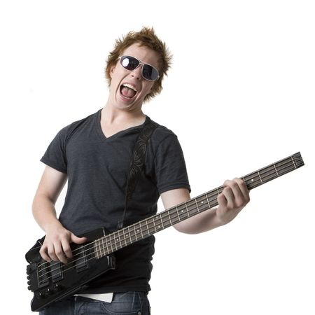 A dude in sunglasses rocks out with an electric bass guitar