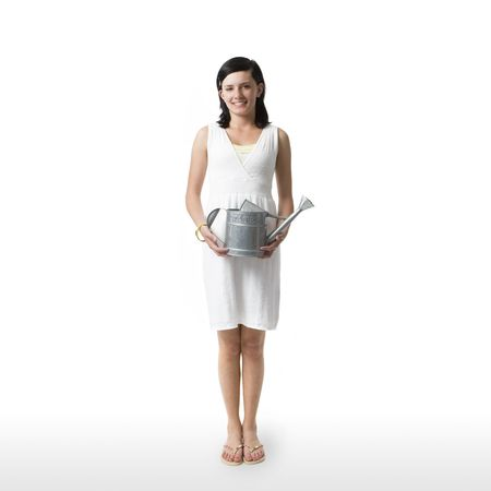 A girl with a watering can against a white background photo