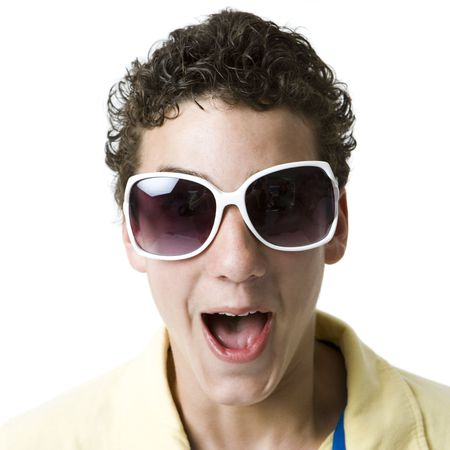 A boy with funky white sunglasses screams Stock Photo
