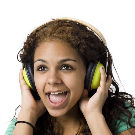 A girl listens to music and screams while wearing green headphones