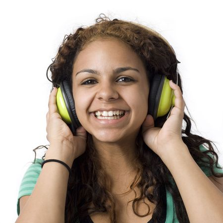 A girl listens to music with green headphones
