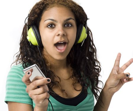 Girl with headphones and media player