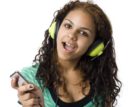 A girl sings and listens to headphones Stock Photo