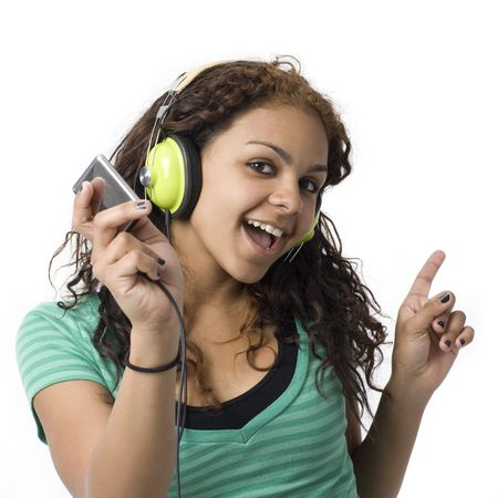 A girl sings along with her headphones and media player Stock Photo - 3829095