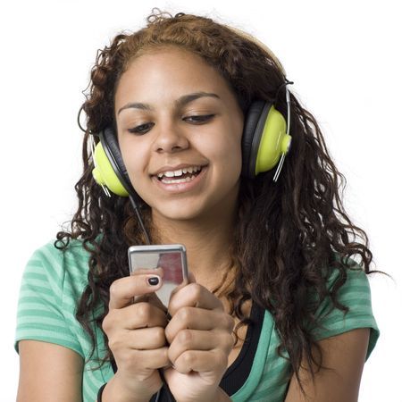 Teenage girl with headphones and media player