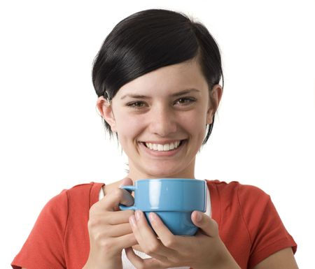 A girl in a red shirt holds a blue cup and smiles Stock Photo - 3829074