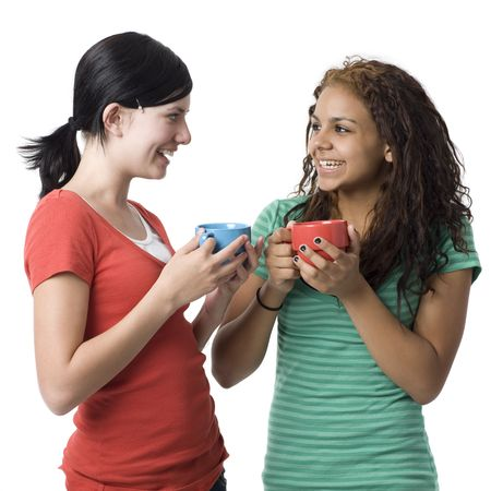 Two girls with cups smiles photo