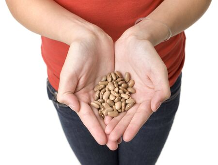 A girl holds a handfull of beans Stock Photo - 3829075