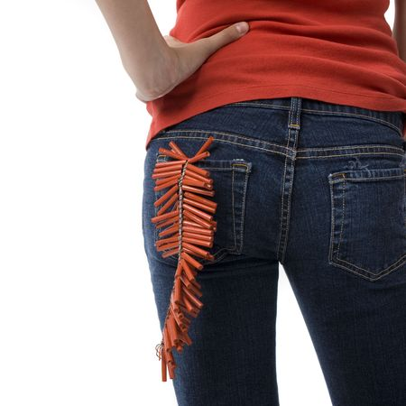 A girl with firecrackers in her back pocket Stock Photo