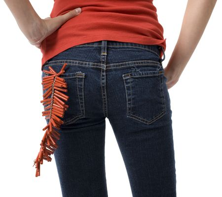 A girl with firecrackers in her back pocket photo