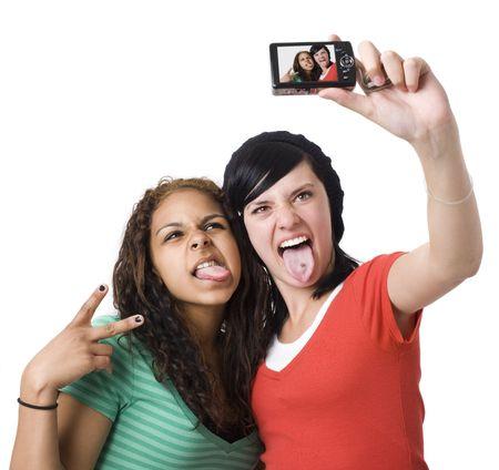 Teens take self portrait with a digital camera photo