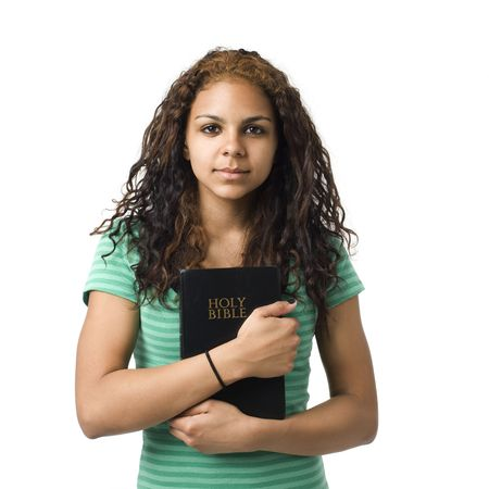 christian faith: Teen girl holds bible in her hands