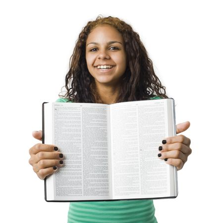 Girl holds bible open Stock Photo