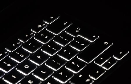 backlit keyboard: An illuminated keyboard on a black background Stock Photo