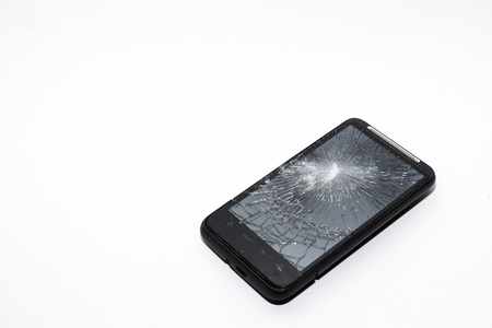 shattered: Smartphone with a shattered screen. Dropped phone, insurance claim