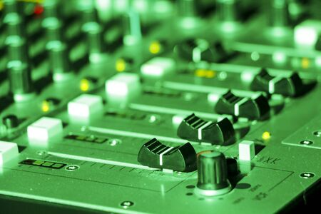 Close up shot of a professional DJ mixer in a club setting