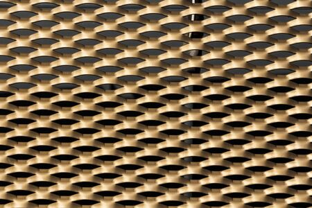grille: Close up shot of a gold coloured grille