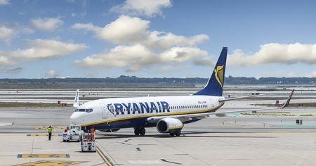 holiday budget: Ryanair aircraft being pushed from its stand at an airport Editorial