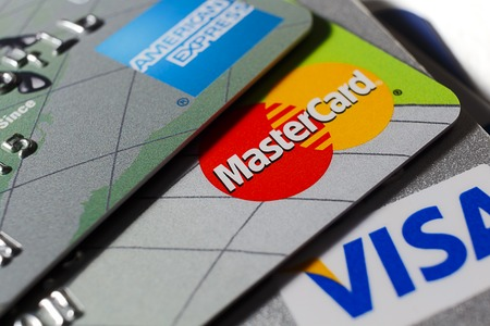 Close up macro shot of mastercard amongst other credit cards Editoriali