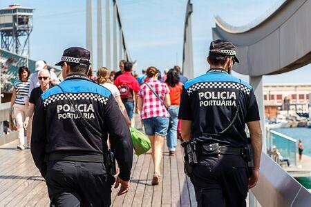 patrol: Rear shot of Policia Portuaria Spanish Port Police on patrol