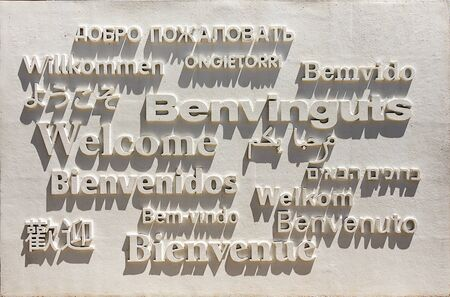 A sign with Welcome written in multiple languages