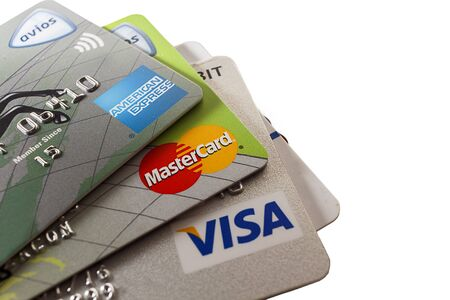 Close up shot of the three major credit cards, white background. Editorial