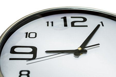 Clock showing 5 past 9, could be late for workingor meeting concept