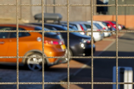 Cars behind bars, could be used as impounded cars concept